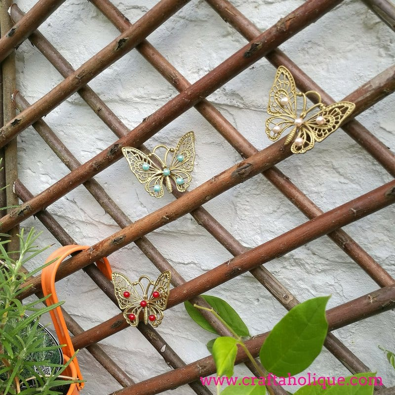 Beaded butterfly garden decor with metal butterfly charms