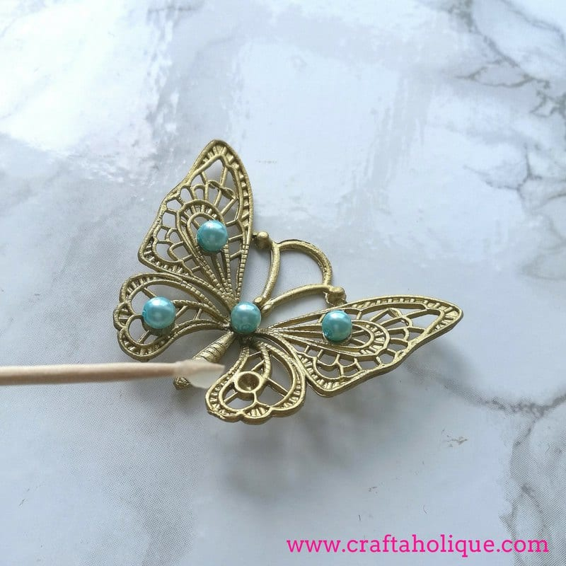 Gluing beads onto metal butterflies with Bostik All Purpose Glue