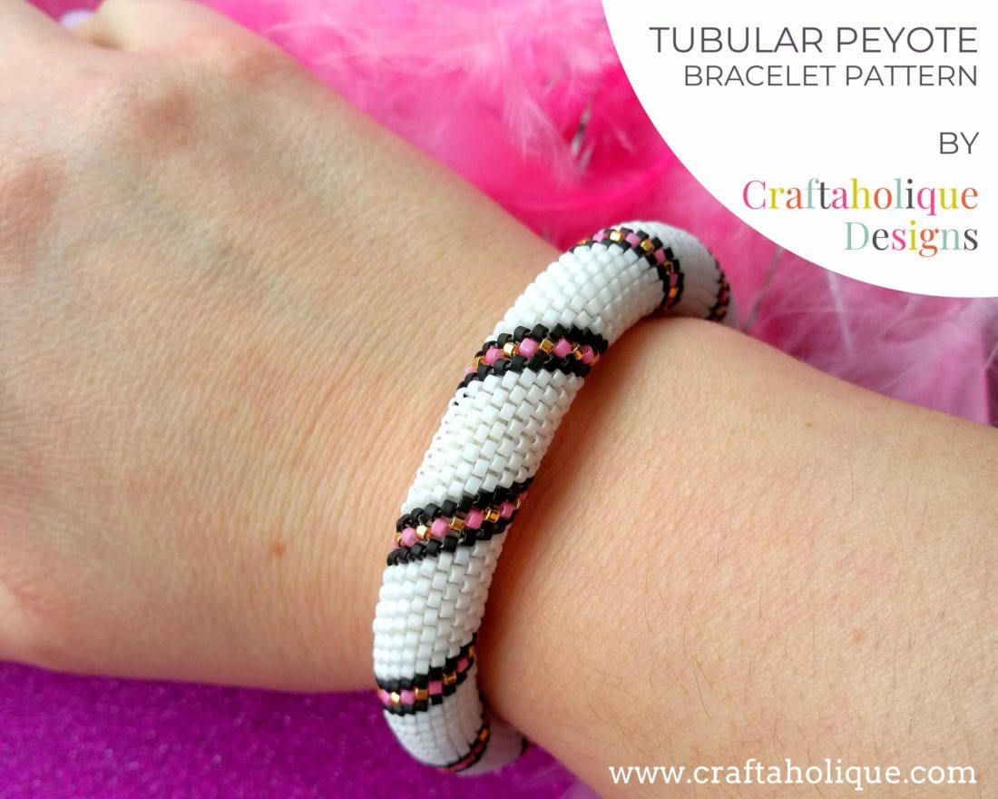 Tubular peyote bracelet pattern with stripe in white, black, pink and gold.