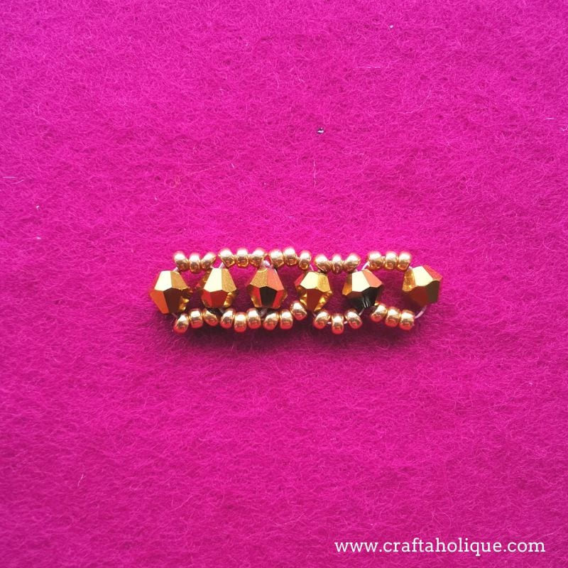 Right angle weave stitch with bicones and seed beads.