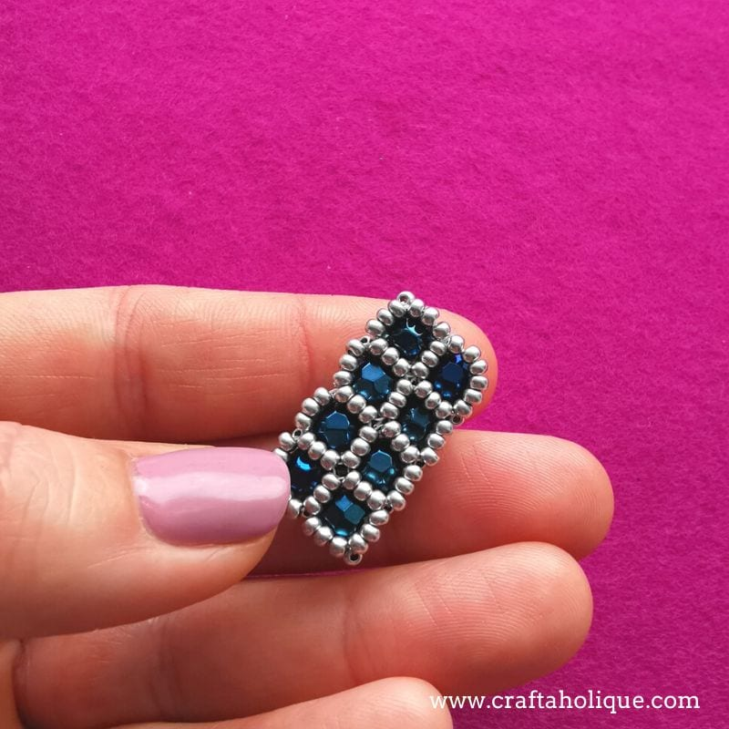 Right angle weave with seed beads and round beads in the windows for embellishments.