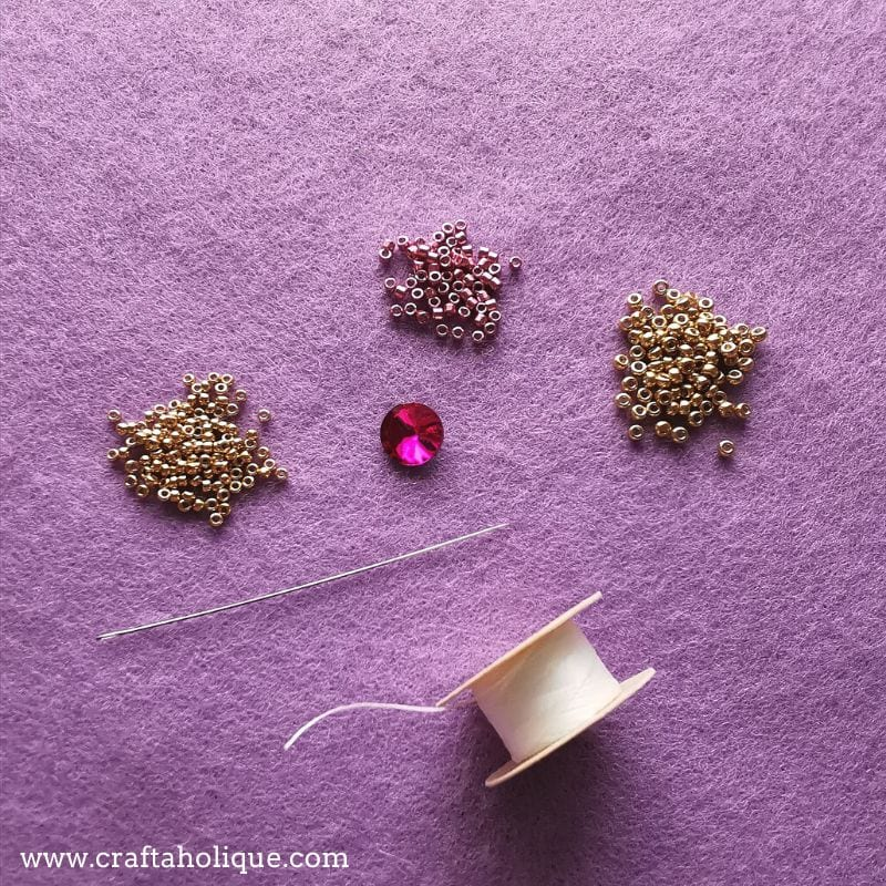 A selection of materials needed to bezel a crystal rivol with Miyuki seed beads and delicas.