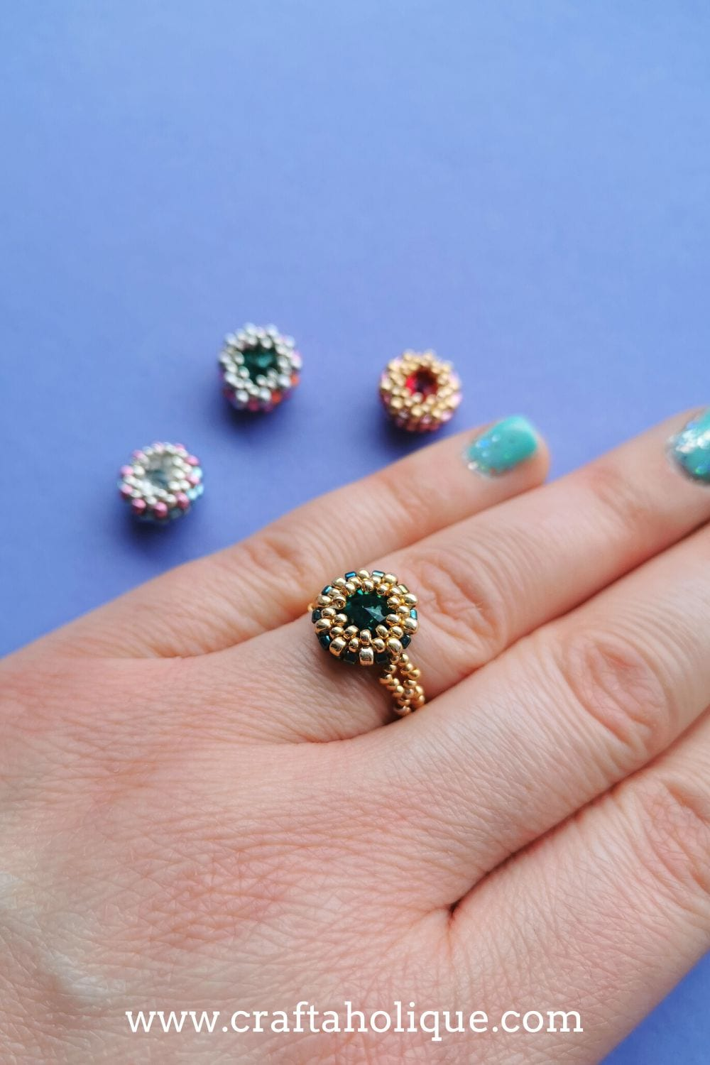 A beaded ring made with a crystal rivoli and a seed bead bezel.